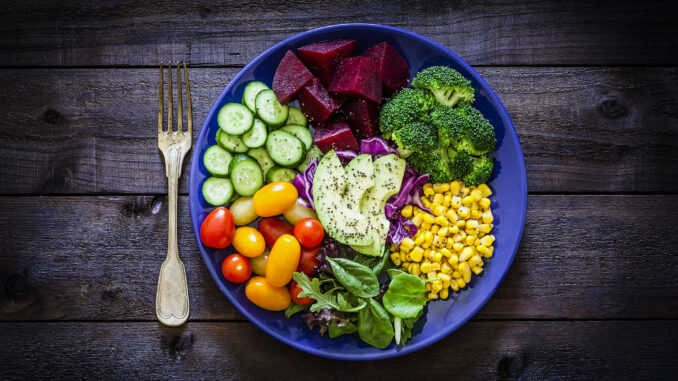 salad mix plate shot from above on rustic wooden royalty free image 1018199524 1556130377