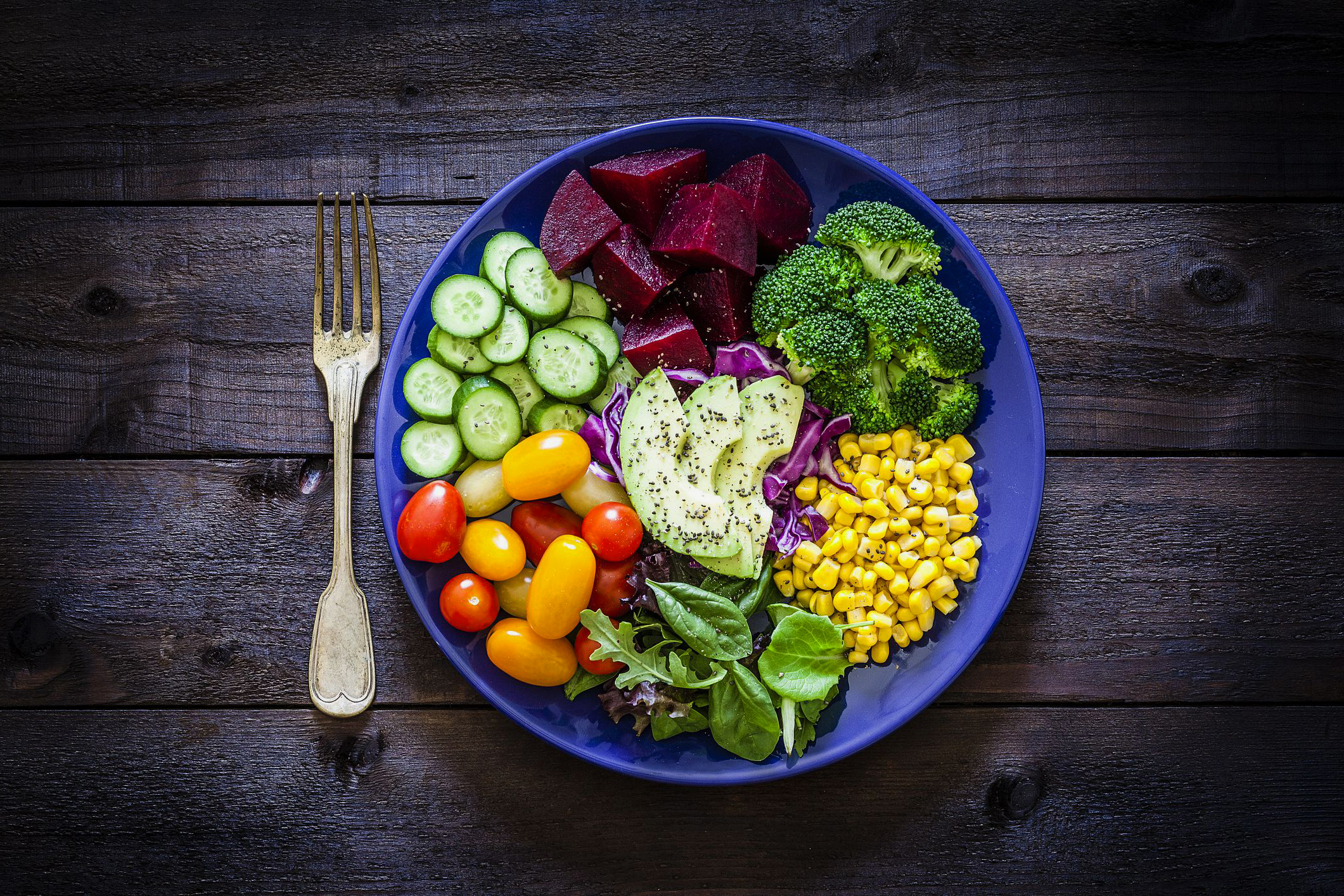 salad-mix-plate-shot-from-above-on-rustic-wooden-royalty-free-image-1018199524-1556130377